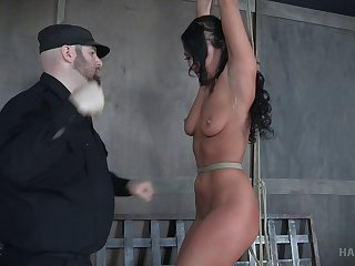 Cute brunette slave whipped by her kinky master during a game