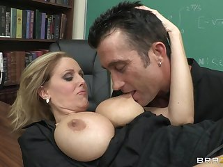 Two teachers fuck in the classroom and the milf in stockings is best bent over the desk.