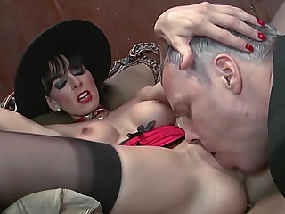 He eats out the girl in collar, lipstick, and lingerie and she receives big cock in her box.