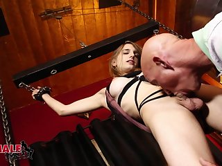 In the dungeon a guy punishes and fucks a horny shemale