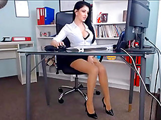Hot beauty gets an orgasm on an office chair