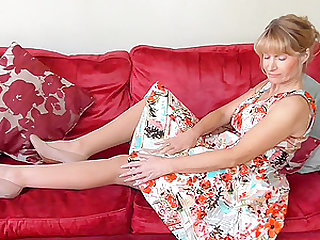 Mature blonde amateur Jane F. takes off her dress on the couch