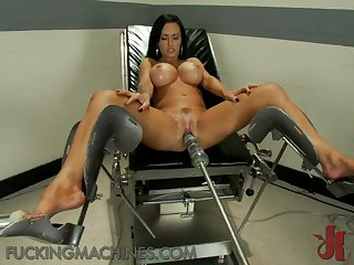 Milf Brunette Shows Off Her Big Tit While Fucking A Machine